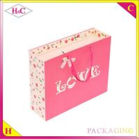 China Red Love hand length handle paperboard wedding gift bag wholesale