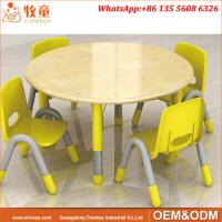 China Day Care Centre High Quality 4 Seats Round Wood Table and Plastic Chairs for 2-5 years old kids on sale