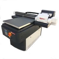China A4 size flatbed UV printer for pvc card,business card,calendar cover to print on sale