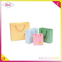 Quality Small Round Poin hand length handle paperboard gift bag for sale