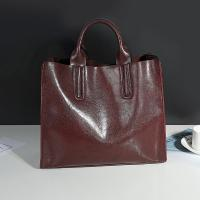 China Cowhide Casual Tote Black Leather Handbags With Mobile Phone / Document Pocket wholesale