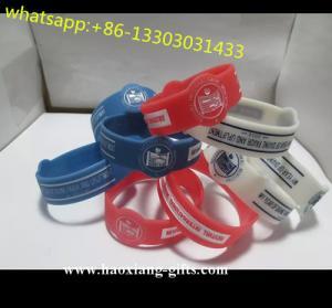 China cheap promotional uv sensitive sport silicone bracelet with custom logos wholesale