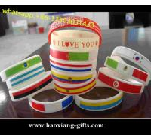 China Custom embossed/imprinted/printed logo Silicone Wristband/bracelet with flag wholesale