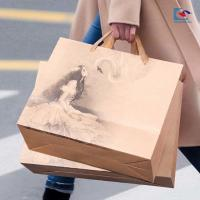 China Brown Kraft Paper carry bag bread packaging bags with paper handle printing wholesale