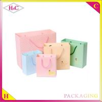 China Small Round Poin hand length handle paperboard gift bag wholesale
