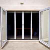 China Anti mosquito waterproof Retractable screen door with pleated net wholesale
