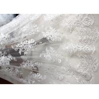 China Luxury Ivory Embroidery Cord Sequin Lace Fabric / French Bridal Sequin Mesh Fabric wholesale