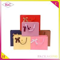 China Hot stampted word hand length handle paperboard gift bag with ribbon wholesale