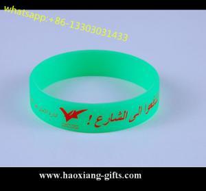 China personalized eco-friendly printing logo silicone wristband/bracelet glow in dark wholesale