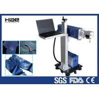 China Online Flying Co2 Jeans Denim portable laser marking machine , small laser engraver wholesale