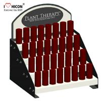 China Custom Logo Counter Cosmetic Display Stand 4-Layer Fancy Store Display Rack wholesale
