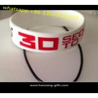 Quality cheap promotional silicone wristband with embossed colourful logo for sale