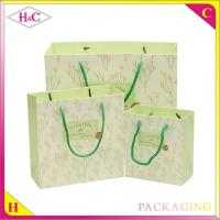 Quality Flower language hand length handle paperboard upscale gift shopping bag for sale