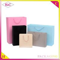 China Pure colour hand length handle paperboard gift shopping bag wholesale