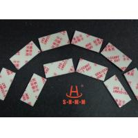 China Fiber Rice Desiccant With Thin Sticker Tape , Food Grade Desiccant Packets 1.0mm Thickness wholesale
