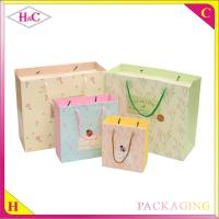 Buy cheap Flower language hand length handle paperboard upscale gift shopping bag from wholesalers