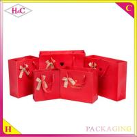 Quality Hot stampted word hand length handle paperboard gift bag with ribbon for sale