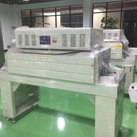 China Automatic Film Shrink Wrapping Machine Heat Tunnel Tube Wrap Packaging Machine wholesale