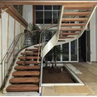 China Indoor use wood step glass railing steel curved staircase wholesale