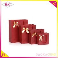 China Manufacture and sale handle paper upscale cheaper wine gift shopping bag with bowknot wholesale