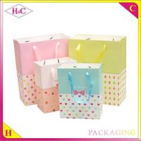 Buy cheap Wholesale hand length handle paper packaging bag from wholesalers