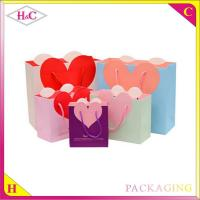 China Heart-Shaped hand length handle paperboard wedding gift bag wholesale