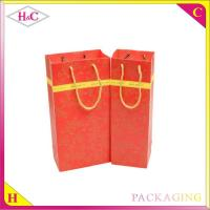 China Luxury handmade reusable paper gift wine bag wholesale