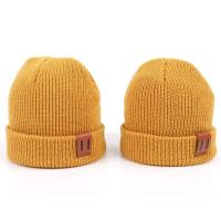 China Leather Patch Knit Beanie Hats Custom Design Warm Hat Cap Yellow Beanie Hats wholesale