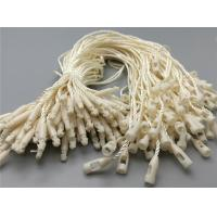 China custom cheap beige cream-coloured plastic seal String hang tag with bullet clasp wholesale
