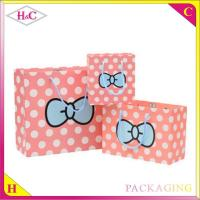 China Dot bowknot hand length handle paperboard gift bag wholesale