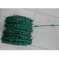 China Green Security Barbed Wire Roll Coil Protection For Grass Boundary wholesale