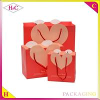 Quality Heart-Shaped hand length handle paperboard wedding gift bag for sale