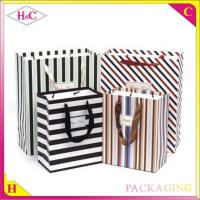 China Striped hand length handle paperboard gift shopping bag wholesale