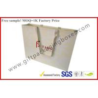 China Branded Custom Paper Gift Bags With Ribbon Handles , Embossing Logo Paper Hand Bags wholesale