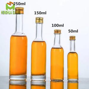China mini round 50ml 100ml 150ml empty glass liquor bottle vodka spirit alcohol glass bottle with cap on sale