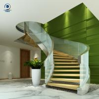 China Prefabricated steel curved staircase with tempered glass balustrade wholesale