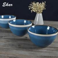 Blue reactive glaze ceramic bowl with brown rim