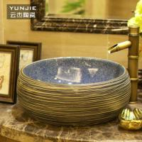 Made in china one piece round stone bathroom sink