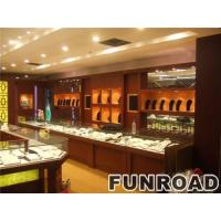 Oval jewelry display kiosk in brand jewelry store with glass display counters